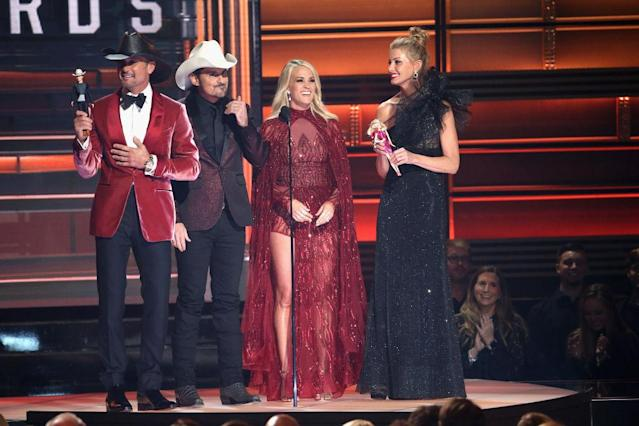 <p>Tim McGraw, Brad Paisley, Carrie Underwood, and Faith Hill speak onstage at the 51st annual CMA Awards at the Bridgestone Arena on November 8, 2017 in Nashville, Tennessee. (Photo by Terry Wyatt/FilmMagic) </p>
