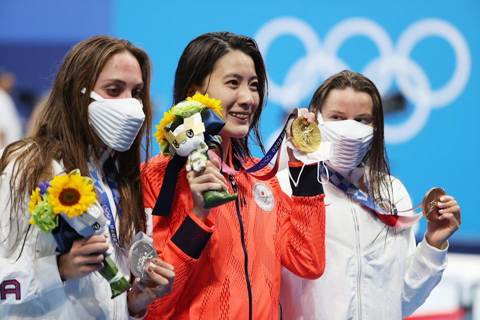 Silver medalist Emma Weyant, gold medalist Yui Ohashi of Team Japan and bronze medalist Hali Flickinger pose with their medals for the Women's 400-meter individual medley.