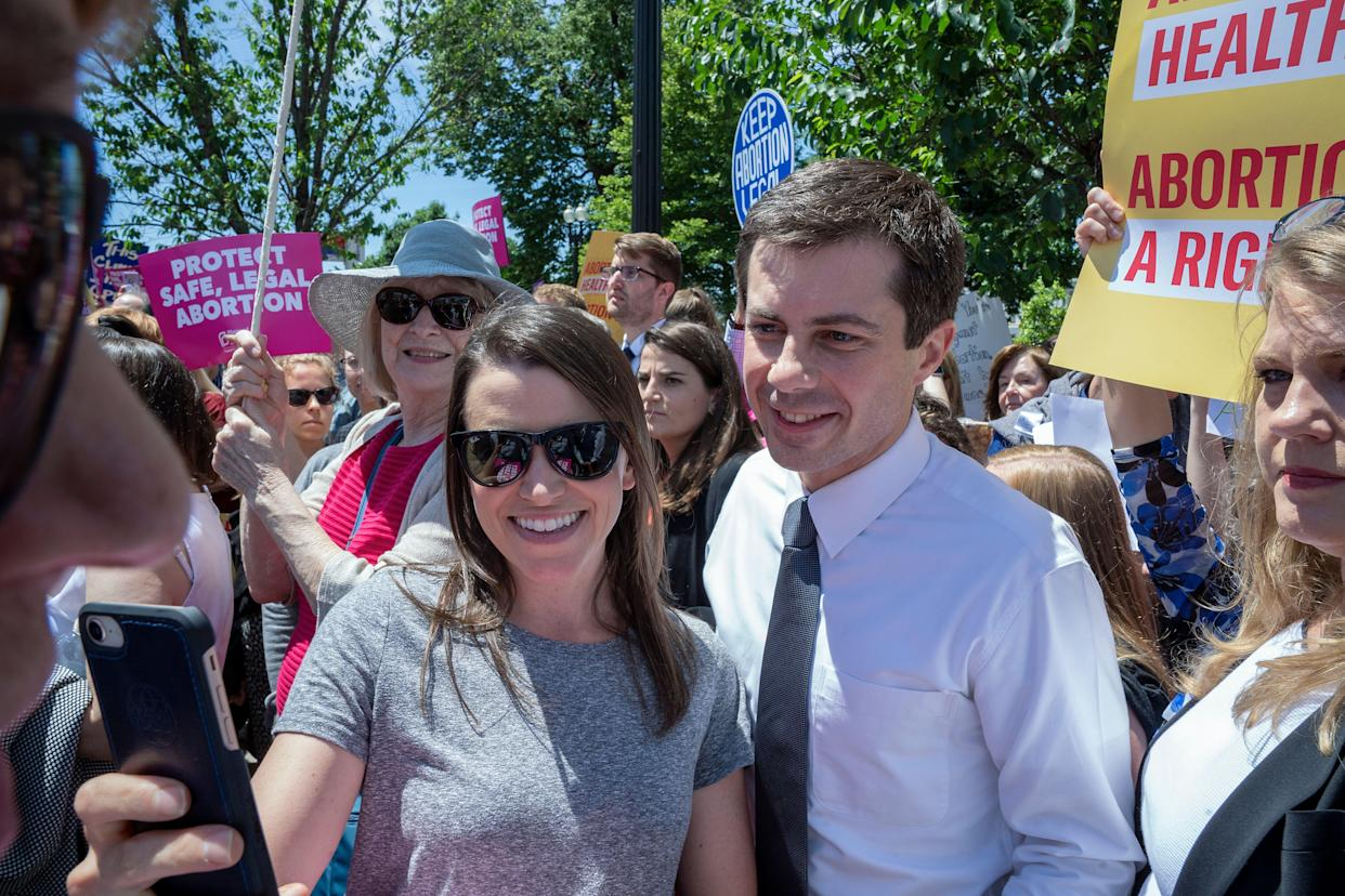 Pete Buttigieg poses with a fan at a pro-abortion-rights rally in Washington, D.C. (Photo: Tasos Katopodis/Getty Images)