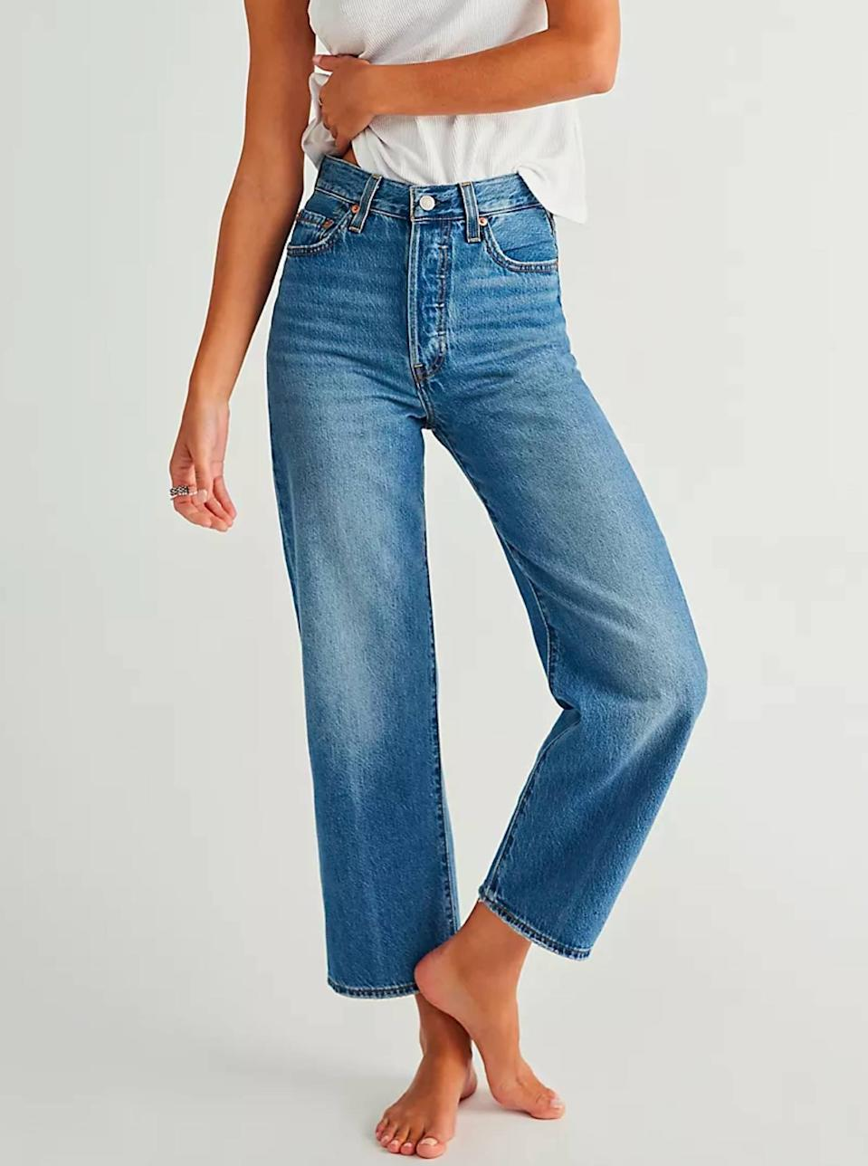 """$98, Free People. <a href=""""https://www.freepeople.com/shop/levis-ribcage-straight-ankle-jeans/?"""" rel=""""nofollow noopener"""" target=""""_blank"""" data-ylk=""""slk:Get it now!"""" class=""""link rapid-noclick-resp"""">Get it now!</a>"""