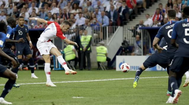 Croatia's Ivan Perisic scores his side's opening goal during the final match between France and Croatia at the 2018 soccer World Cup in the Luzhniki Stadium in Moscow, Russia, Sunday, July 15, 2018. (AP Photo/Petr David Josek)