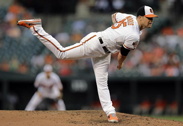 Baltimore Orioles starting pitcher Bud Norris follows through on a pitch to the Boston Red Sox in the third inning of a baseball game, Monday, June 9, 2014, in Baltimore. (AP Photo/Patrick Semansky)