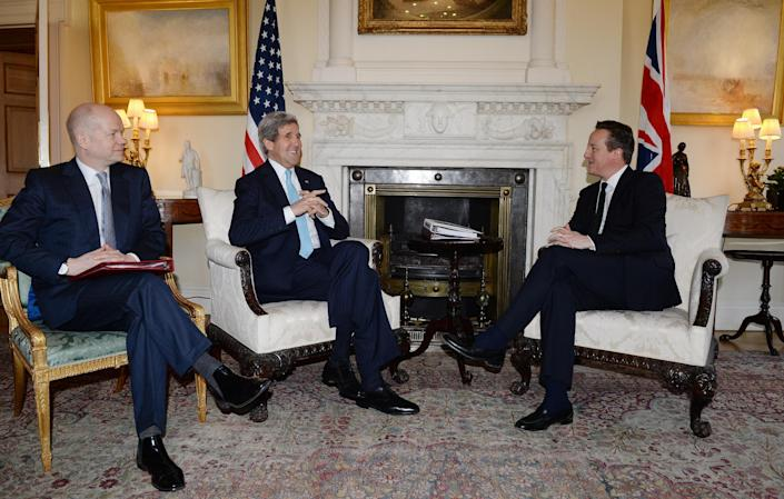 Britain's Prime Minister David Cameron, right, and Foreign Secretary William Hague, left, meet with US Secretary of State John Kerry in Downing Street, central London, Friday March 14, 2014. U.S. Secretary of State John Kerry flew to London on Friday to meet with Russian Foreign Minister Sergey Lavrov in a last-minute bid to stave off a new chapter in the East-West crisis over Ukraine. (AP Photo/Andy Rain, Pool)