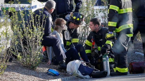 PHOTO: A woman is aided by first responders after sustaining injury on a bike path in lower Manhattan in New York, NY, Oct. 31, 2017. (Brendan McDermid/Reuters)