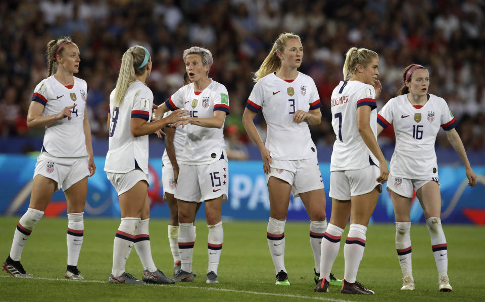United States' Megan Rapinoe, third right, reacts with teammate Julie Ertz during the Women's World Cup quarterfinal soccer match between France and the United States at Parc des Princes in Paris, France, Friday, June 28, 2019. (AP Photo/Alessandra Tarantino)