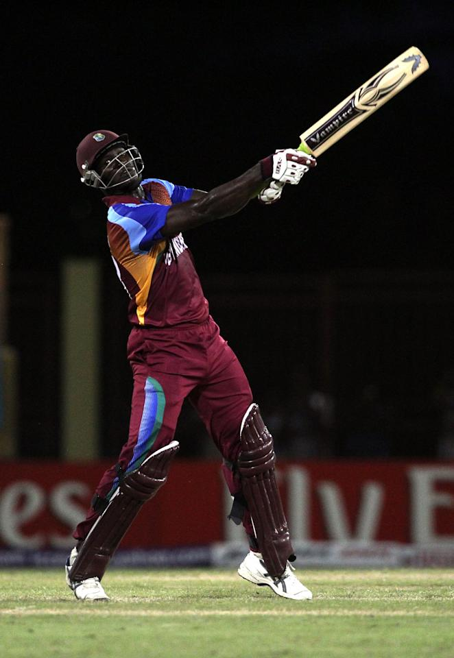 PROVIDENCE, GUYANA - APRIL 30:  Darren Sammy of West Indies hits out during the ICC T20 World Cup Group D match between West Indies and Ireland at the Guyana National Stadium Cricket Ground on April 30, 2010 in Providence, Guyana.  (Photo by Clive Rose/Getty Images)