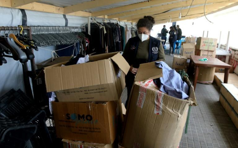 A charity worker sorts donated clothes inside a tent of the Grassroots organisation in Beirut's Mar Mikhael district