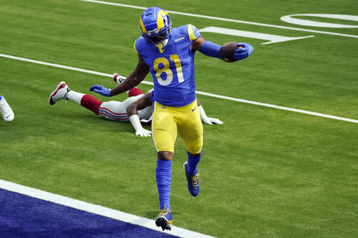 Los Angeles Rams tight end Gerald Everett (81) scores against the New York Giants during the first half of an NFL football game Sunday, Oct. 4, 2020, in Inglewood, Calif. (AP Photo/Ashley Landis)