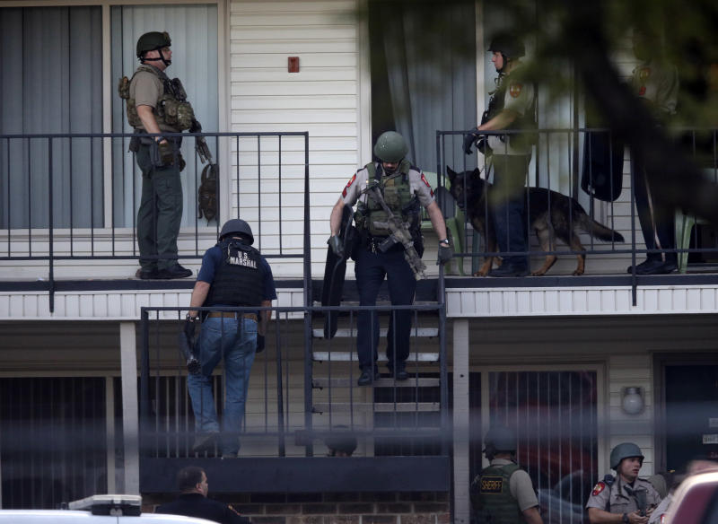 Law enforcement officers leave after entering an apartment near the scene where a mother was killed and her baby kidnapped Tuesday, April 17, 2012, in Spring, Texas. Investigators say a mother was fatally shot and her newborn son abducted outside a suburban Houston pediatric center. (AP Photo/David J. Phillip)