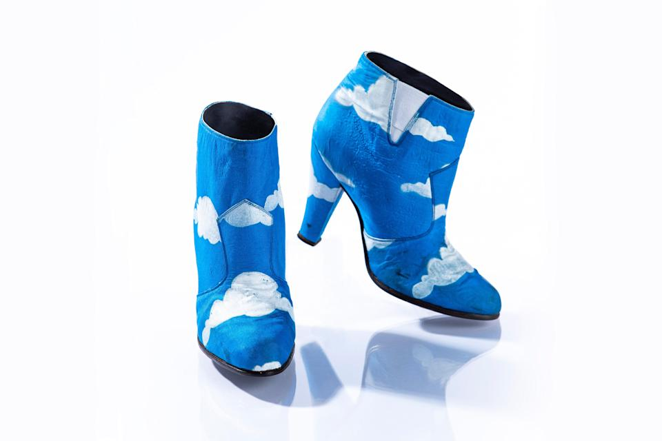 """Prince wore these blue ankle boots with hand-painted white clouds in his """"Raspberry Beret"""" music video, along with a matching suit."""