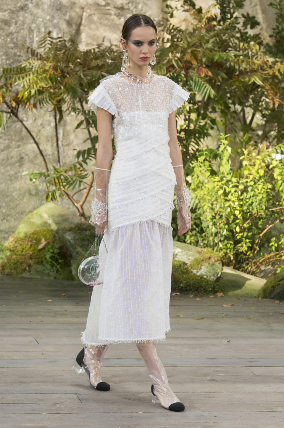 <p><i>Short-sleeve white crystal embellished dress from the SS18 Chanel collection. (Photo: ImaxTree) </i></p>