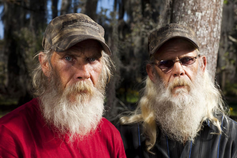 "In this undated image released by History, Mitchell Guist, left, and his brother Glenn, from the series ""Swamp People,"" are shown. Authorities in Louisiana say a man who starred in the reality television show ""Swamp People"" died from natural causes. Ascension Parish Sheriff Jeff Wiley says the parish coroner, Dr. John Fraiche, made that determination after a preliminary autopsy on Mitchell Guist. Guist, who appeared in segments of the ""Swamp People"" with his brother, Glenn, died after collapsing Monday, May 14, 2012 while working on a houseboat he was building on Belle River. (AP Photo/History, Zach Dilgard)"