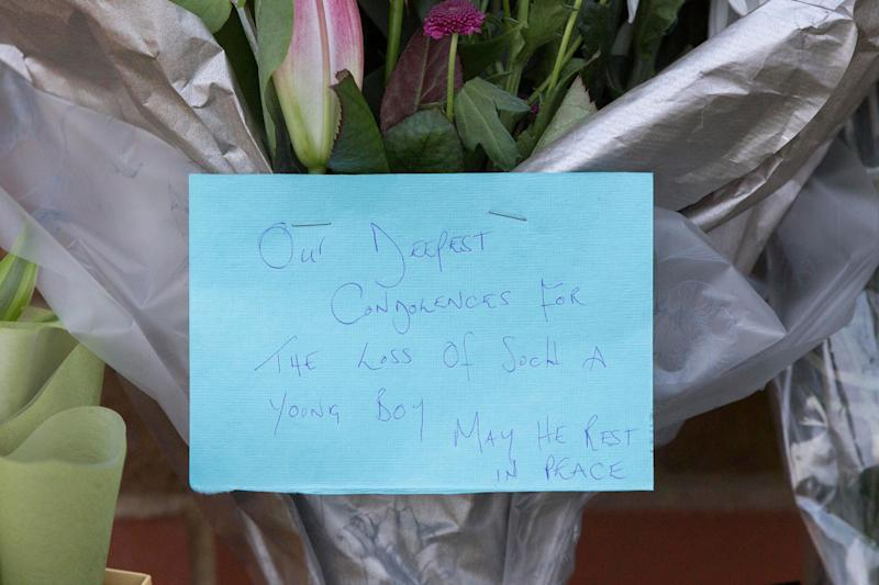 Flowers and tributes have been left at the scene  (Photo: PA Wire/PA Images)