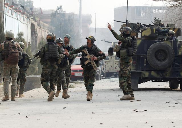 <p>Afghan security forces arrive at the site of a blast and gun fire in Jalalabad, Afghanistan, Jan. 24, 2018. (Photo: Parwiz/Reuters) </p>