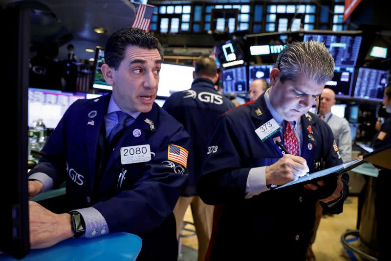 Dow suffers record decline in points as Wall St. leads global stocks lower