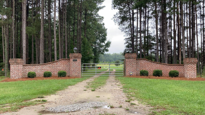 The gates near Alex Murdaugh's home in Islandton, S.C., are seen in this Monday, Sept. 20, 2021 photo. State police have six separate investigations into Murdaugh and his family after his wife and son were shot to death outside the home in June. (AP Photo/Jeffrey Collins)
