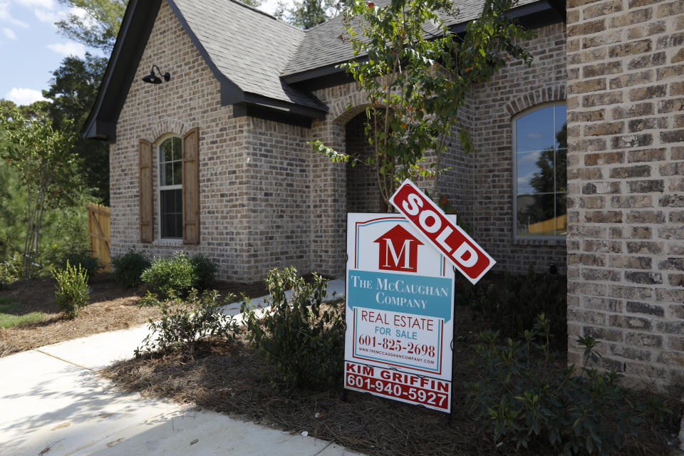 "A sign indicating a ""Sold"" house sits atop a realty company's lawn sign in Brandon Miss., Wednesday, Sept. 25, 2019. (AP Photo/Rogelio V. Solis)"