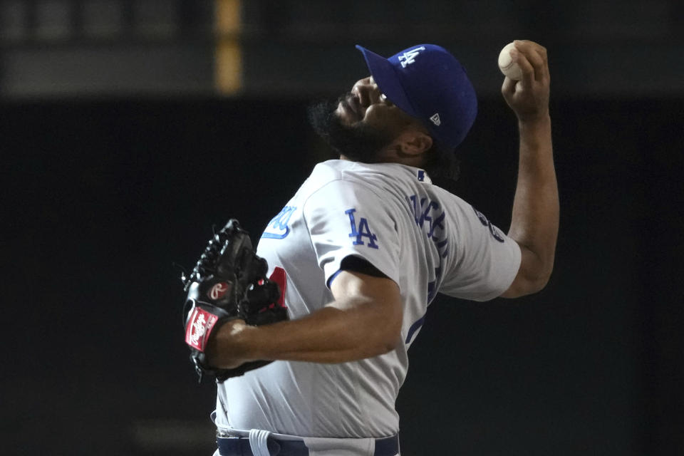 Los Angeles Dodgers relief pitcher Kenley Jansen throws against the Arizona Diamondbacks in the ninth inning during a baseball game, Sunday, June 20, 2021, in Phoenix. (AP Photo/Rick Scuteri)