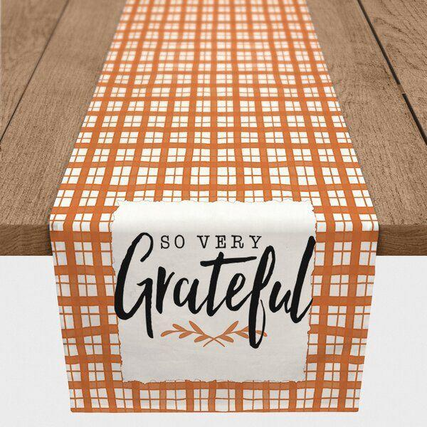 """<p><strong>Gracie Oaks</strong></p><p>wayfair.com</p><p><strong>$46.90</strong></p><p><a href=""""https://go.redirectingat.com?id=74968X1596630&url=https%3A%2F%2Fwww.wayfair.com%2Fkitchen-tabletop%2Fpdp%2Fgracie-oaks-mornington-so-very-grateful-table-runner-w000982322.html&sref=https%3A%2F%2Fwww.womansday.com%2Flife%2Fg33660033%2Fthanksgiving-tablecloths%2F"""" rel=""""nofollow noopener"""" target=""""_blank"""" data-ylk=""""slk:Shop Now"""" class=""""link rapid-noclick-resp"""">Shop Now</a></p><p>This table runner has just the right amount of pizzazz, and looks oh-so festive with its orange color scheme and message of gratitude. </p>"""