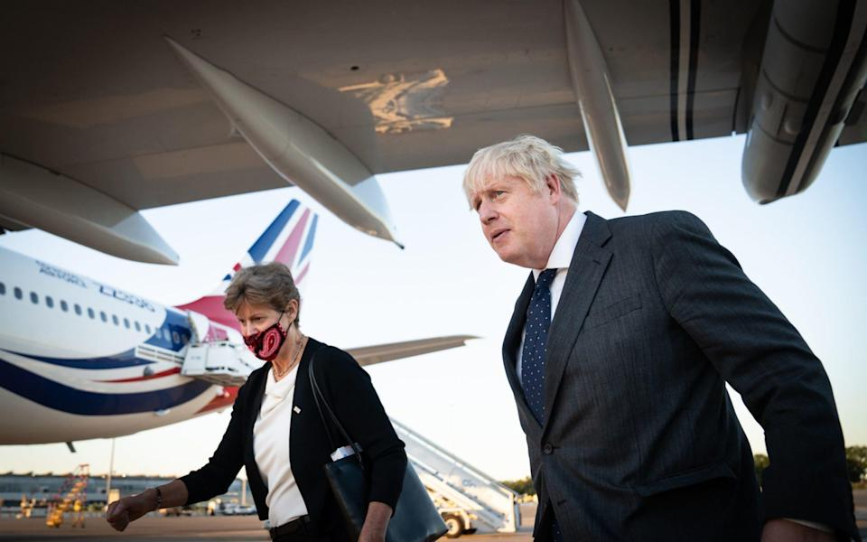 Boris Johnson with Dame Barbara Janet Woodward, Permanent Representative of the United Kingdom to the United Nations as he lands in New York - PA