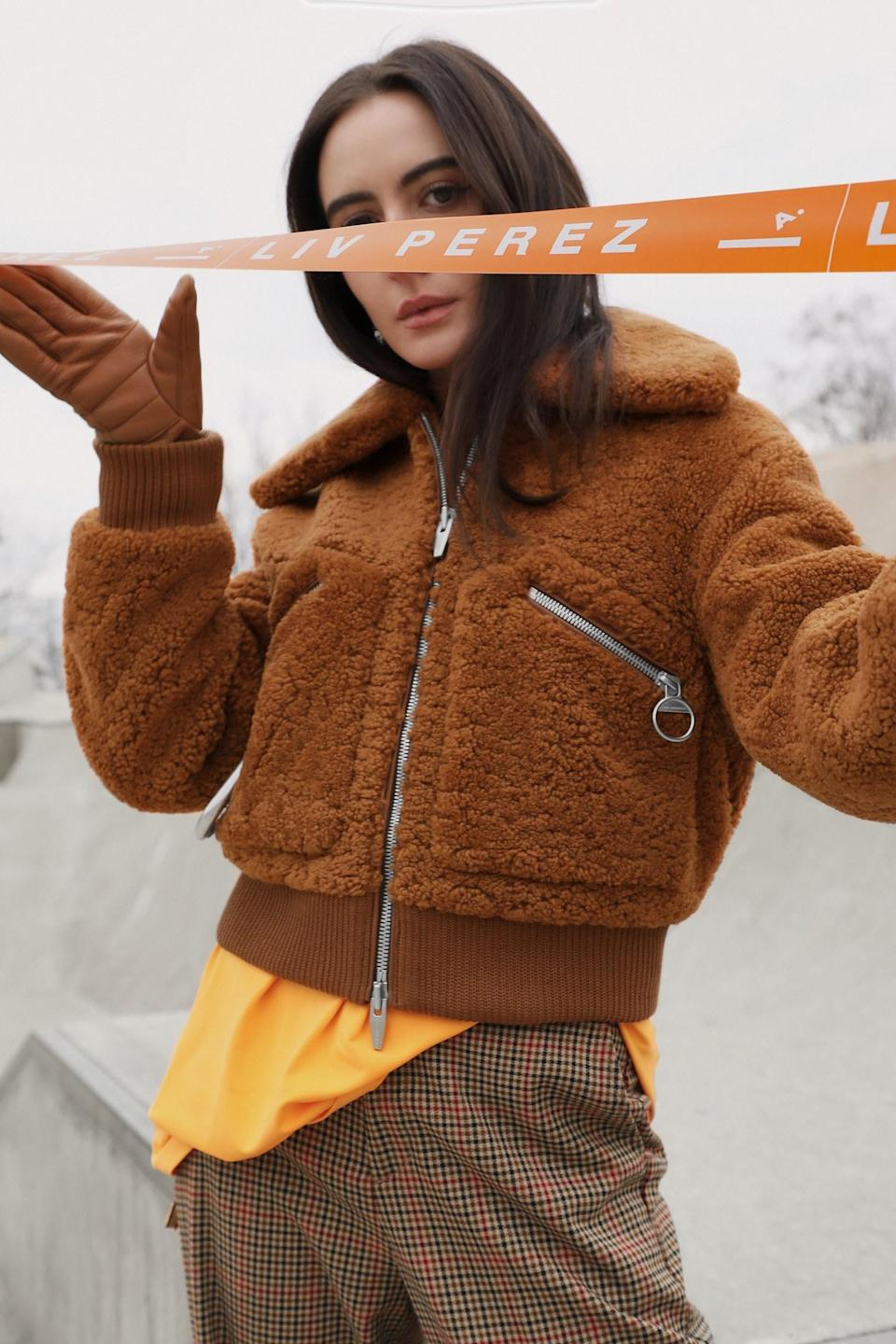 """Introducing the Lamborghini of teddy coats made by everyone's favorite luxury coat brand, <a href=""""https://thearrivals.com/"""" rel=""""nofollow noopener"""" target=""""_blank"""" data-ylk=""""slk:The Arrivals"""" class=""""link rapid-noclick-resp"""">The Arrivals</a>. This coat doesn't just look cool; it's actually made (and proven) to endure extreme weather conditions. It's also made with the best materials and expert craftsmanship, and comes with a lifetime warranty (something most coats don't have). It's also known to sell out (with a waiting list of more than 900), so if you're looking to make a big investment, the <a href=""""https://thearrivals.com/products/kala#natural"""" rel=""""nofollow noopener"""" target=""""_blank"""" data-ylk=""""slk:Kala Teddy Bomber"""" class=""""link rapid-noclick-resp"""">Kala Teddy Bomber</a> is a good one to consider. It'll never go out of style, and you can wear it for all the fall and winters to come. $895, The Arrivals. <a href=""""https://thearrivals.com/products/kala#natural"""" rel=""""nofollow noopener"""" target=""""_blank"""" data-ylk=""""slk:Get it now!"""" class=""""link rapid-noclick-resp"""">Get it now!</a>"""