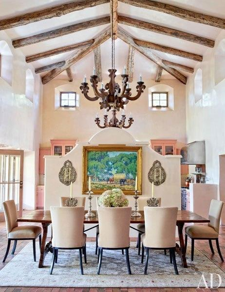"""<p>A 1922 painting by American Impressionist Alson Skinner Clark hangs on the room divider, which Architectural Digest says was copied from a California mission; on <a href=""""http://archdg.st/1oZ7v74"""" rel=""""nofollow noopener"""" target=""""_blank"""" data-ylk=""""slk:the backside of the divider"""" class=""""link rapid-noclick-resp"""">the backside of the divider</a> is a massive and stunning carved walnut buffet from 19th-century Peru.<a href=""""http://archdg.st/1oYTZR3"""" rel=""""nofollow noopener"""" target=""""_blank"""" data-ylk=""""slk:Click here to read more about Jane Fonda's ranch"""" class=""""link rapid-noclick-resp""""> Click here to read more about Jane Fonda's ranch</a> on ArchitecturalDigest.com, and <a href=""""http://archdg.st/1oZ5IPj"""" rel=""""nofollow noopener"""" target=""""_blank"""" data-ylk=""""slk:click here to see more pictures on AD's site"""" class=""""link rapid-noclick-resp"""">click here to see more pictures on AD's site</a>. <i>(Photo: Simon Upton/Architectural Digest)</i> <br></p>"""