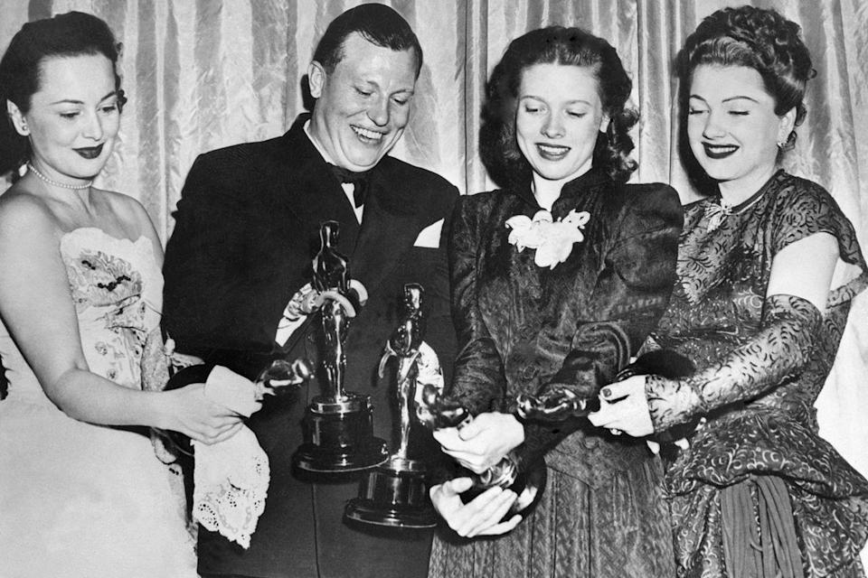 <p> Harold Russell held his two Oscars (Best Supporting Actor and an honorary award) alongside Olivia De Havilland, Cathy O'Donnell, and Anne Baxter. Harold lost both hands during an army training exercise and is one of only two people to win acting Oscars despite not being a professional actor. </p>