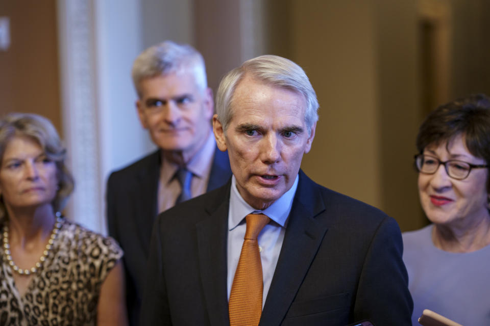 Sen. Rob Portman, R-Ohio, the lead GOP negotiator in the infrastructure talks, is joined by, from left, Sen. Lisa Murkowski, R-Alaska, Sen. Bill Cassidy, R-La., and Sen. Susan Collins, R-Maine, as he announces an agreement with Democrats on a $1 trillion infrastructure bill, saying they are ready to vote to take up the bill, at the Capitol in Washington, Wednesday, July 28, 2021. (AP Photo/J. Scott Applewhite)