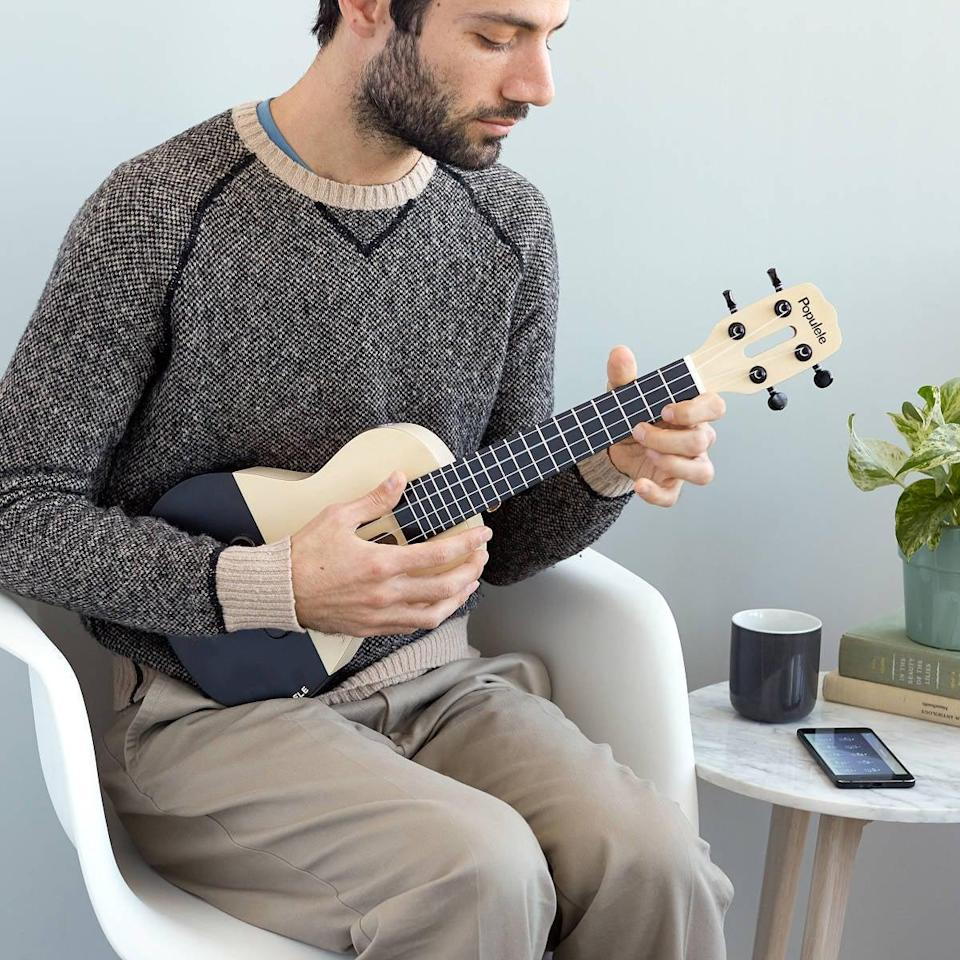 <p>Learn how to play the ukulele in your free time with this <span>Smart Ukulele</span> ($150). It is app guided, so you can learn at your own pace.</p>