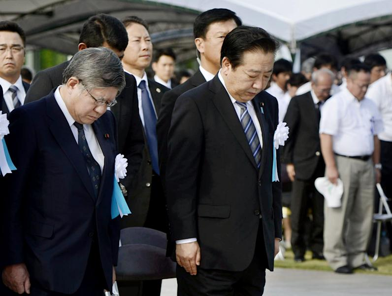 Japan's Prime Minister Yoshihiko Noda center, offers silent prayer during the ceremony to mark the 67th anniversarty of the atomic bombing at the Peace Memorial Park in Hiroshima, western Japan, Monday, Aug. 6, 2012. (AP Photo/Kyodo News) JAPAN OUT, MANDATORY CREDIT, NO LICENSING IN CHINA, HONG KONG, JAPAN, SOUTH KOREA AND FRANCE