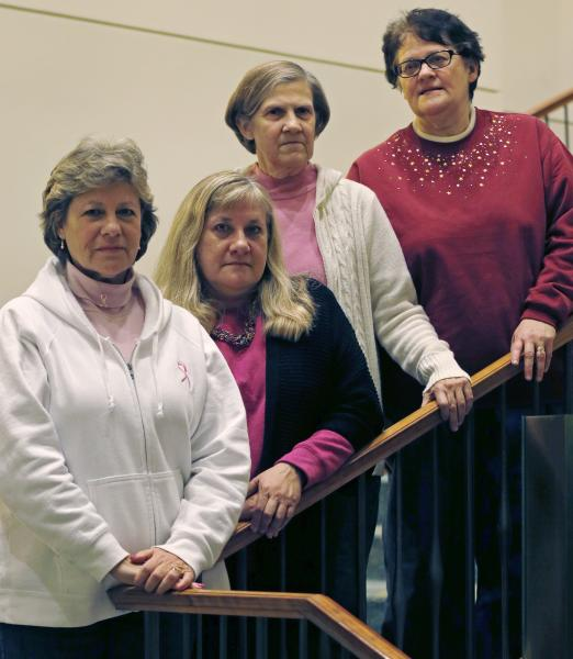 The Melnick sisters, who are suing Eli Lilly and Co. alleging that a synthetic estrogen known as DES caused them all to get breast cancer, pose at their hotel in Boston, Monday evening, Jan. 7, 2013. Testimony is set to begin in their federal lawsuit against the drug maker on Tuesday Jan. 8th. From left are Michele Fecho, Francine Melnick, Donna McNeely, Andrea Andrews. (AP Photo/Charles Krupa)