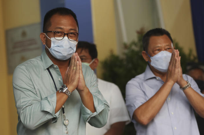 President Director of Sriwijaya Air Jefferson Irwin Jauwena, left, gestures to journalists during a press conference at a hospital in Jakarta, Indonesia, Tuesday, Jan. 12, 2021. Indonesian navy divers were searching through plane debris and seabed mud Tuesday looking for the black boxes of a Sriwijaya Air jet that nosedived into the Java Sea over the weekend with 62 people aboard. (AP Photo/Achmad Ibrahim)