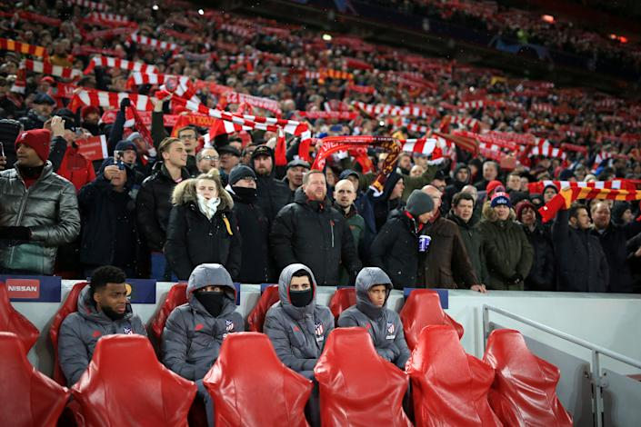 LIVERPOOL, ENGLAND - MARCH 11: Atletico substitutes sit on the bench surrounded by Liverpool fans during the UEFA Champions League round of 16 second leg match between Liverpool FC and Atletico Madrid at Anfield on March 11, 2020 in Liverpool, United Kingdom. (Photo by Simon Stacpoole/Offside/Offside via Getty Images)