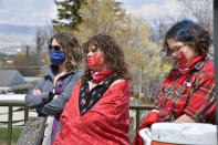Women listen to speakers during a ceremony to commemorate missing and murdered indigenous people in front of the Montana state Capitol in Helena, Mont., Wednesday, May 5. 2021. From Washington to Indigenous communities across the American Southwest, top government officials, family members and advocates gathered Wednesday as part of a call to action to address the ongoing problem of violence against Indigenous women and children. (AP Photo/Iris Samuels)