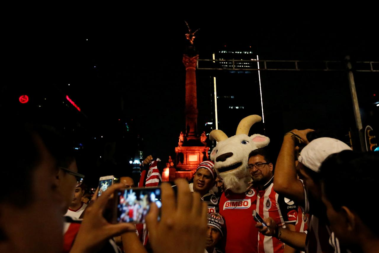 Fans of Chivas de Guadalajara celebrates at the Angel de la Independencia monument after winning the Mexican First Division Final, in Mexico City, Mexico May 28, 2017.  REUTERS/Carlos Jasso