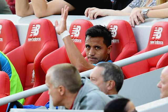 Alexis Sanchez appeared to wave goodbye to Arsenal from the Liverpool bench – but he's not been sold
