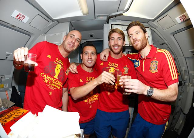IN FLIGHT - JULY 02: In this handout image supplied by the Royal Spanish Football Federation, (L-R) Pepe Reina, Santi Cazorla, Sergio Ramos and Xabi Alonso of Spain celebrate following their team's victory in the UEFA EURO 2012 final match against Italy onboard the Spain team's airplane during their flight back to Madrid on July 2, 2012 in flight. (Photo by Carmelo Rubio Sanchez/RFEF via Getty Images)