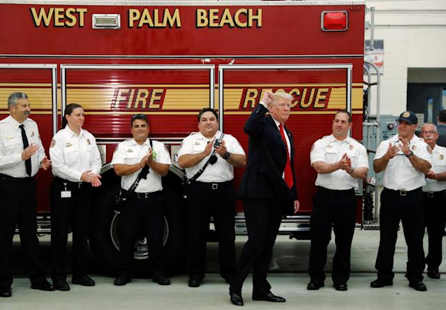 <p>U.S. President Donald Trump departs after greeting members of the West Palm Beach Fire Rescue squads at one of their stations in West Palm Beach, Florida, U.S. December 27, 2017. REUTERS/Jonathan Ernst </p>