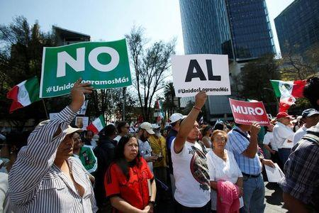 """Demonstrators hold placards that collectively read """"No wall"""" during a march to protest against U.S. President Donald Trump's proposed border wall, and to call for unity, in Mexico City, Mexico"""