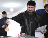 Chechnya's regional leader Ramzan Kadyrov casts his ballot at a polling station during the Parliamentary elections in Akhmat-Yurt, Russia, Saturday, Sept. 18, 2021. Sunday will be the last of three days voting for a new parliament, but there seems to be no expectation that United Russia, the party devoted to President Vladimir Putin, will lose its dominance in the State Duma. (AP Photo/Musa Sadulayev)