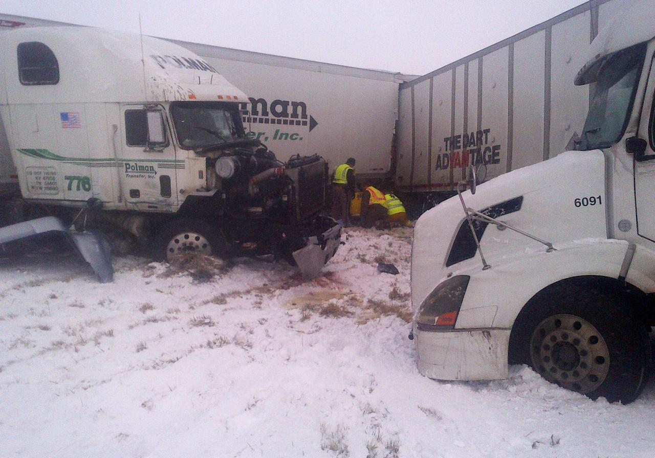 This photo provided by the Iowa State Patrol shows the scene of a 25-vehicle pileup that killed three people Thursday, Dec. 20, 2012 north of Des Moines, Iowa. Authorities said drivers were blinded by blowing snow and didn't see vehicles that had slowed or stopped on Interstate 80 about 60 miles north of Des Moines. A chain reaction of crashes involving semitrailers and passenger cars closed down a section of the highway. (AP Photo/Iowa State Patrol)