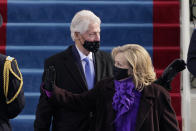 Former President Bill Clinton and his wife former Secretary of State Hillary Clinton arrive for the 59th Presidential Inauguration at the U.S. Capitol for President-elect Joe Biden in Washington, Wednesday, Jan. 20, 2021. (AP Photo/Patrick Semansky, Pool)