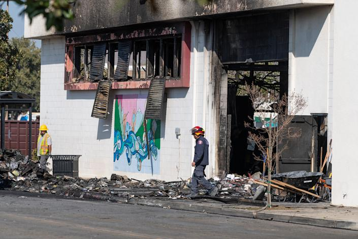 California fire crews from Visalia, Tulare and other agencies remove debris from the Porterville City Library on Febr. 20. Two firefighters were killed when the building went up in flames.