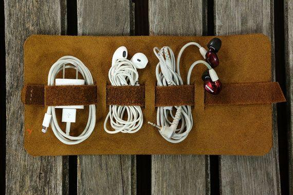 """There's nothing more frustrating that opening your carry on bag to discover your cords are an impossibly knotted mess. This travel pouch will keep things organized while on the go. <strong><a href=""""https://www.etsy.com/listing/476026021/leather-cord-wrap-leather-cord-cable"""" target=""""_blank"""" rel=""""noopener noreferrer"""">Get it here</a></strong>."""