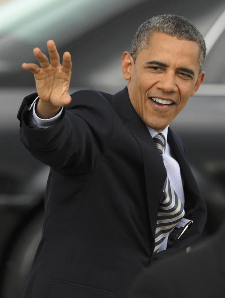 President Barack Obama waves to a small crowd after arriving at O'Hare International Airport in Chicago, Friday, June, 1, 2012. (AP Photo/Paul Beaty)