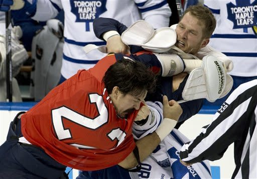 Florida Panthers' George Parros, left, and Toronto Maple Leafs' Colton Orr fight during the first period of an NHL hockey game in Sunrise, Fla., Monday, Feb. 18, 2013. (AP Photo/J Pat Carter)
