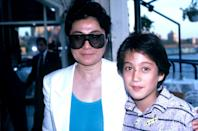 <p>Yoko keeps a low profile, while attending a New York event with son, Sean Lennon, in 1986. Yoko and husband John Lennon welcomed Sean in 1975.</p>