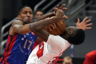 Detroit Pistons guard Rodney McGruder (17) fouls Toronto Raptors forward Chris Boucher (25) during the first half of an NBA basketball game Wednesday, March 3, 2021, in Tampa, Fla. (AP Photo/Chris O'Meara)