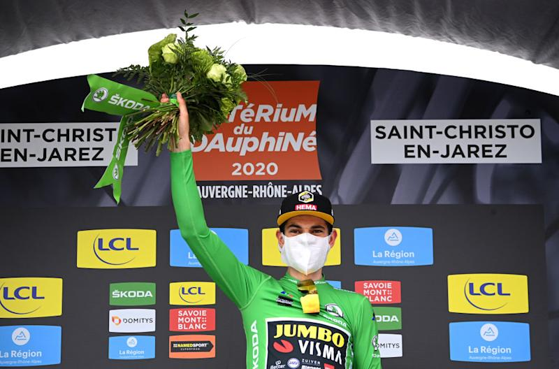 SAINT CHRISTO EN JAREZ FRANCE AUGUST 12 Podium Wout Van Aert of Belgium and Team Jumbo Visma Green Points Jersey Celebration Flowers Covid safety measures during the 72nd Criterium du Dauphine 2020 Stage 1 a 2185km stage from Clermont Ferrand to Saint Christo en Jarez 752m dauphine Dauphin on August 12 2020 in Saint Christo en Jarez France Photo by AnneChristine Poujoulat PoolGetty Images
