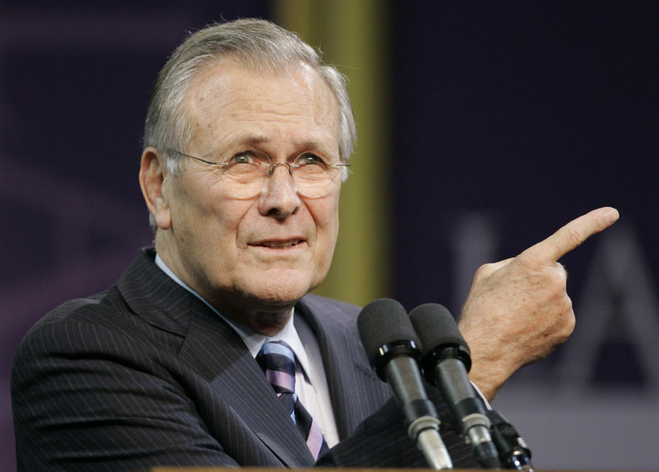 FILE - In this Nov. 9, 2006, file photo, Defense Secretary Donald Rumsfeld asks for another question following his Landon Lecture at Kansas State University in Manhattan, Kan. The family of Rumsfeld says he died Tuesday, June 29, 2021. He was 88. (AP Photo/Orlin Wagner)